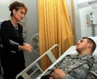 Gov. Sarah Palin visits Army Private James Pattison at Landstuhl Regional Medical Center, Landstuhl , Germany (Credit: Airman 1st Class Kenny Holston)