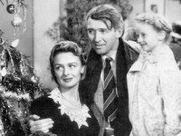 Screenshot of Jimmy Stewart and Donna Reed in the American film It's a Wonderful Life (1946).